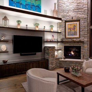 Living room - large contemporary open concept medium tone wood floor and brown floor living room idea in Salt Lake City with white walls, a corner fireplace, a stone fireplace and a media wall