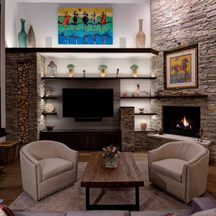 Inspiration for a large contemporary open concept medium tone wood floor and brown floor living room remodel in Salt Lake City with white walls, a corner fireplace, a stone fireplace and a media wall