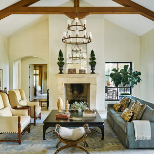 Example Of A Tuscan Formal Living Room Design With Beige Walls, A Standard  Fireplace And