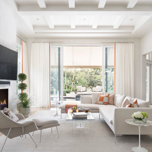 Example of a large trendy open concept medium tone wood floor and brown floor living room design in Miami with gray walls, a standard fireplace, a tile fireplace and a wall-mounted tv