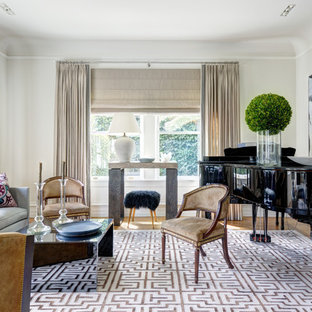 Example of a transitional medium tone wood floor living room design in New York with white walls