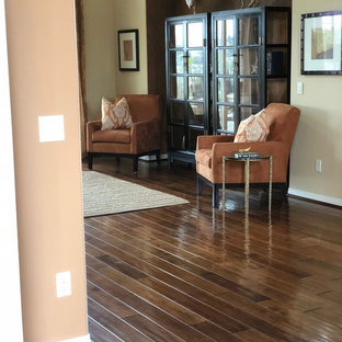 Example of a mid-sized island style formal and enclosed medium tone wood floor and brown floor living room design in San Diego with beige walls and no tv