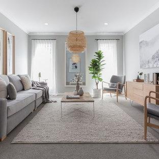 Repräsentatives, Abgetrenntes Nordisches Wohnzimmer mit grauer Wandfarbe, Teppichboden und grauem Boden in Melbourne