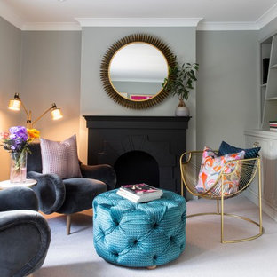 Design ideas for a medium sized classic enclosed living room in Essex with a reading nook, grey walls, carpet, a standard fireplace, a plastered fireplace surround and beige floors.