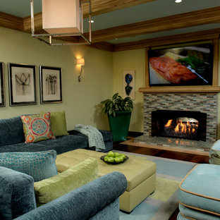 Large elegant open concept dark wood floor living room photo in Orange County with green walls, a standard fireplace, a tile fireplace, a bar and a wall-mounted tv
