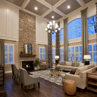 Traditional formal open concept living room in Boston with white walls, dark hardwood floors, a standard fireplace and a stone fireplace surround.