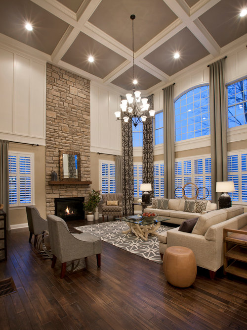 example of a classic formal and open concept dark wood floor living room design in boston