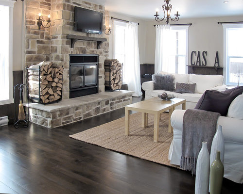 Trendy living room photo in Montreal with a standard fireplace, a stone  fireplace and a