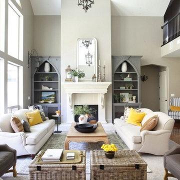 European Splendor,  living room, black leather sofa, fireplace, mantle, built in