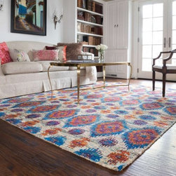 Exciting Contemporary Trends - The radiant Giselle Collection is hand knotted entirely of refurbished sari silks from India. Each design reverberates in stunning colors like ruby red and sapphire blue that make for an incredibly vibrant collection, ideal for contemporary to transitional interiors