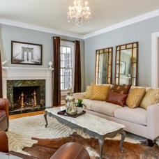 Traditional Living Room by Astounding Surroundings Staging