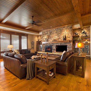 Expansive Living Room with Stacked stone fireplace