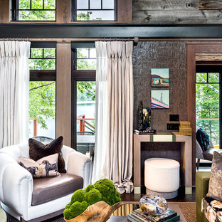 Exposed metal beams bring an industrial quality to this rustic modern lake house