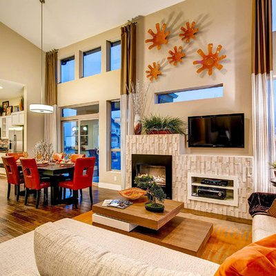 Example of a trendy open concept living room design in Denver with beige walls, a standard fireplace and a wall-mounted tv