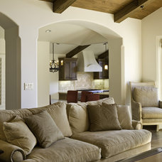 Mediterranean Living Room by Claudio Ortiz Design Group, Inc.