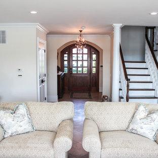 ニューヨークの広いシャビーシック調のおしゃれなLDK (フォーマル、ベージュの壁、セラミックタイルの床、コーナー設置型暖炉、木材の暖炉まわり、テレビなし) の写真