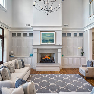 Living room - mid-sized traditional open concept medium tone wood floor living room idea in Atlanta with gray walls, a standard fireplace and a concrete fireplace