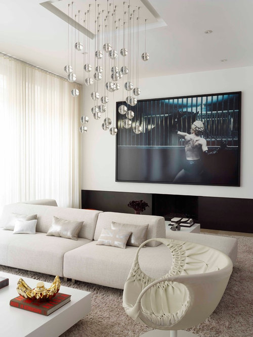 Example of a trendy living room design in New York with white walls and a  wall