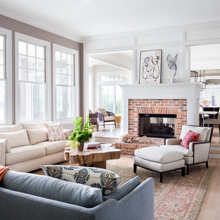 Example of a large transitional formal and open concept light wood floor and beige floor living room design in New York with a two-sided fireplace, a brick fireplace and white walls
