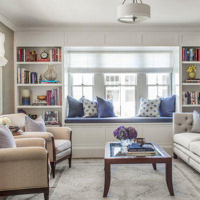 Example of a mid-sized classic formal and enclosed medium tone wood floor living room design in Boston with beige walls