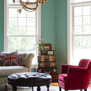 Elegant medium tone wood floor living room photo in Philadelphia with green walls