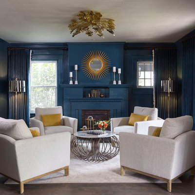 Example of a mid-sized transitional formal and enclosed dark wood floor living room design in Denver with blue walls, no tv and a standard fireplace
