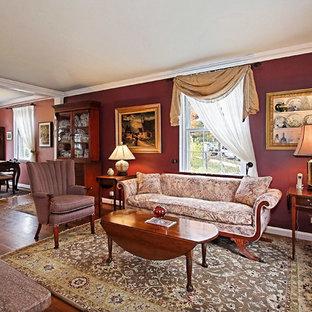 Foto på ett vintage vardagsrum, med röda väggar