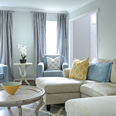 Example of a transitional living room design in DC Metro with blue walls