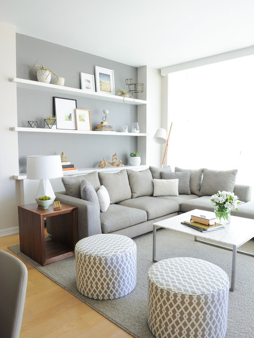 example of a danish open concept living room design in vancouver with gray walls and light