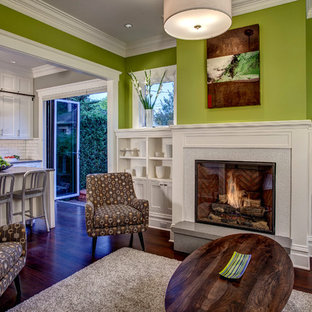 Inspiration for a craftsman open concept living room remodel in Seattle with green walls, a standard fireplace and a tile fireplace