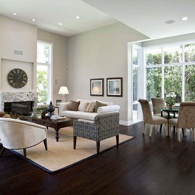 Living room - contemporary open concept dark wood floor and brown floor living room idea in San Francisco with gray walls, a standard fireplace, a stone fireplace and no tv