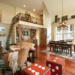 Example of a mid-sized mountain style open concept medium tone wood floor and brown floor living room design in Nashville with beige walls