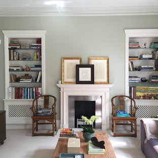 Transitional formal living room photo in London with a standard fireplace and a metal fireplace