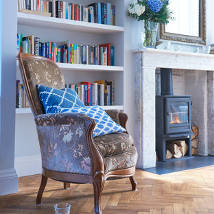 Inspiration for a large traditional formal open plan living room in London with white walls, dark hardwood flooring, a wood burning stove and a stone fireplace surround.