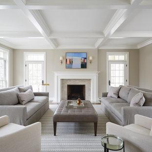 Cette image montre un grand salon traditionnel avec un mur beige, une cheminée standard, un manteau de cheminée en pierre, aucun téléviseur, une salle de réception et un plafond à caissons.