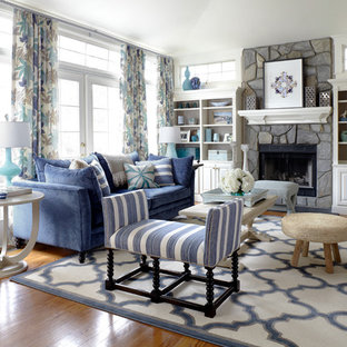 Living room - coastal formal medium tone wood floor living room idea in New York with white walls, a standard fireplace and a stone fireplace