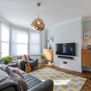 Medium Sized Contemporary Enclosed Living Room In London With Grey Walls A Wall Mounted Tv