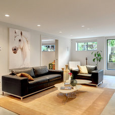 Contemporary Living Room by Meister Construction Ltd