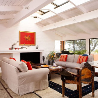 Inspiration for a beach style open concept concrete floor living room remodel in San Francisco with white walls, a standard fireplace and no tv