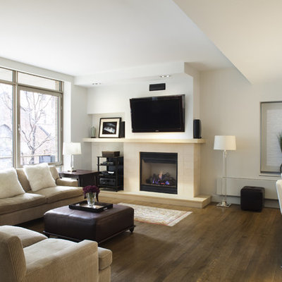 Trendy open concept dark wood floor living room photo in New York with white walls, a standard fireplace and a wall-mounted tv