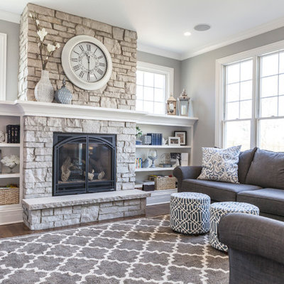 Example of a mid-sized transitional formal and enclosed dark wood floor and brown floor living room design in Chicago with gray walls, a standard fireplace, a stone fireplace and no tv