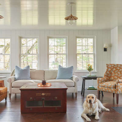 Example of a large country formal and open concept dark wood floor and brown floor living room design in New York with white walls and a wood stove