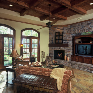 Inspiration for a large craftsman formal and open concept porcelain floor living room remodel in Houston with beige walls, a corner fireplace, a brick fireplace and a media wall