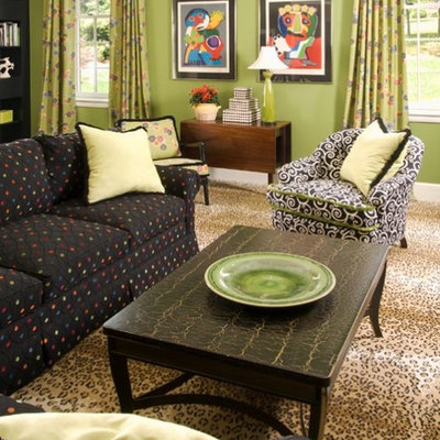 Living room - traditional living room idea in Charlotte with green walls