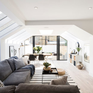 Inspiration for a scandi living room in London with white walls and light hardwood flooring.