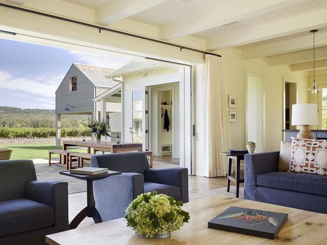 Farmhouse Living Room by JMA (Jim Murphy and Associates)
