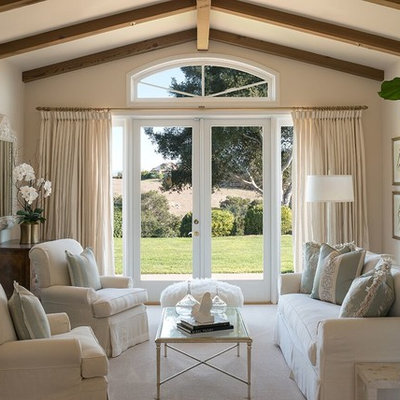 Living room - farmhouse living room idea in Santa Barbara with beige walls, a standard fireplace and a stone fireplace