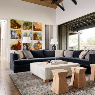 Living room - farmhouse medium tone wood floor living room idea in San Francisco with white walls