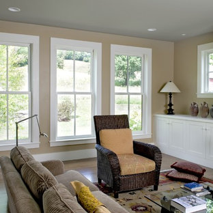 Example of a country living room design in Burlington with beige walls