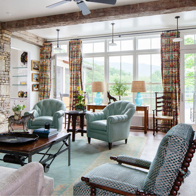 Farmhouse enclosed dark wood floor living room photo in Other with white walls, a standard fireplace and a stone fireplace